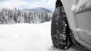 winter tires on car in snow